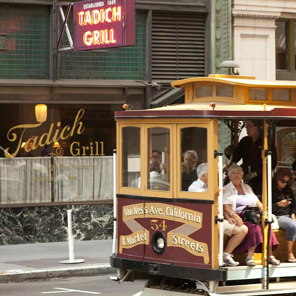 Outside Tadich Grill with Trolley car passing